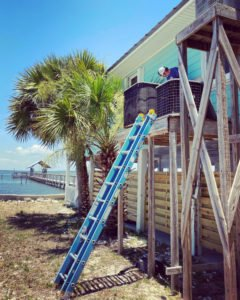 Patrick working on an AC in Indian Pass Florida